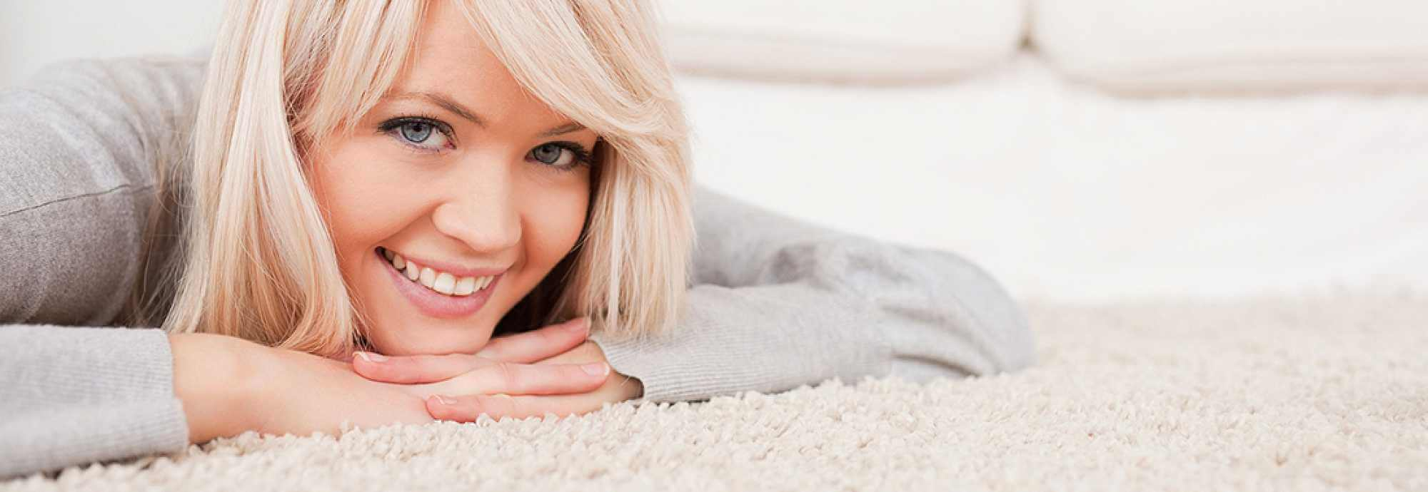 happy woman laying on the carpet