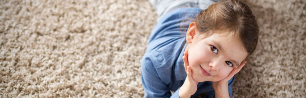 Smiling Child on Clean Carpet